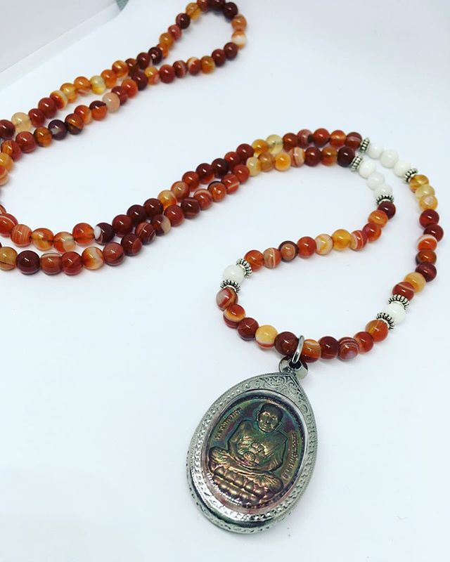 And last of this bunch The Peace of Chiang Mai Mala $70 Handcrafted with a Genuine Thai Amulet made by the Wat Sa Kae Temple, Fire Agate and Mother-of-pearl stones. #edmontonartist #theurbangypsy #yegartist #edmontonmade #yegmade #bycurated #malanecklace #thaiamulets