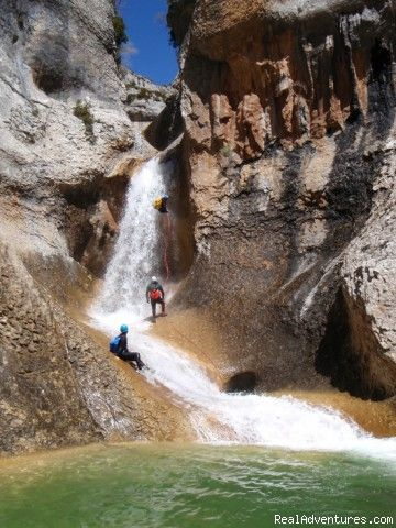 Abseil and tobogan in a canyon: Canyoning and adventure in Sierra de Guara - Spain