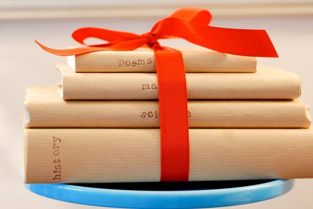 Cover a stack of books in brown paper for back to school decorations