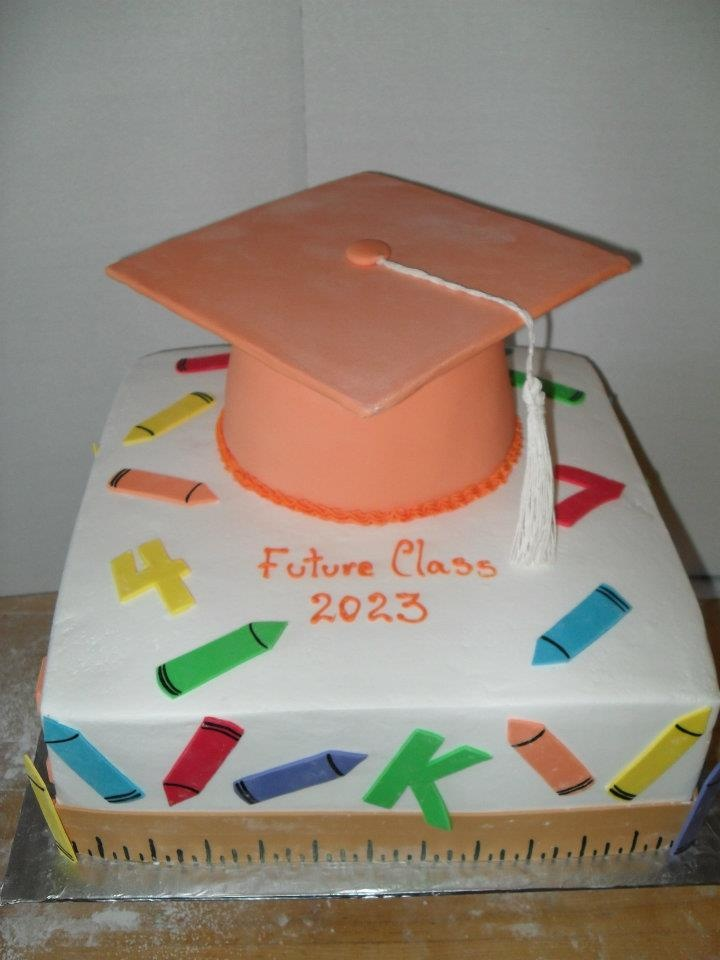 elementary school graduation cake with crayons, cap, colors, and rulers by Katrina's Bakery 250 Jefferson Street Fall River, MA 02721 (508)674-5051 Find us on Facebook!
