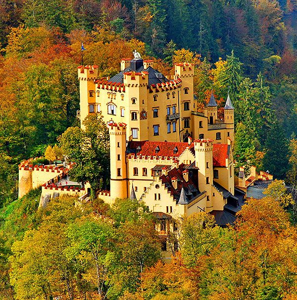 Schloss Hohenschwangau (Hohenschwangau Castle), Bavaria, Germany. Hohenschwangau, near Füssen, Ostallgäu, Bavaria, Germany... http://www.castlesandmanorhouses.com ... Schloss Hohenschwangauor (lit: Upper Swan County Castle) is a 19th-century palace in southern Germany. It was the childhood residence of King Ludwig II of Bavaria and had been built by his father, King Maximilian II of Bavaria. It is located close to the border with Austria.