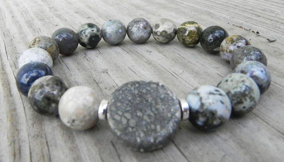 """This bracelet features Ocean Jasper, and pyrite center stone. Strung on a stretch cord that will slip on and off with ease. This bracelet looks great worn alone or paired with others. ()   * All jewelry is handmade in my studio.  * Bracelets are on average sized to 7"""" average wrist. Please contact me and accommodations can be made if your size is above or below that range.  * Processing time is 1-2 days.  * US orders are shipped first class mail. Thank you for visiting my shop"""
