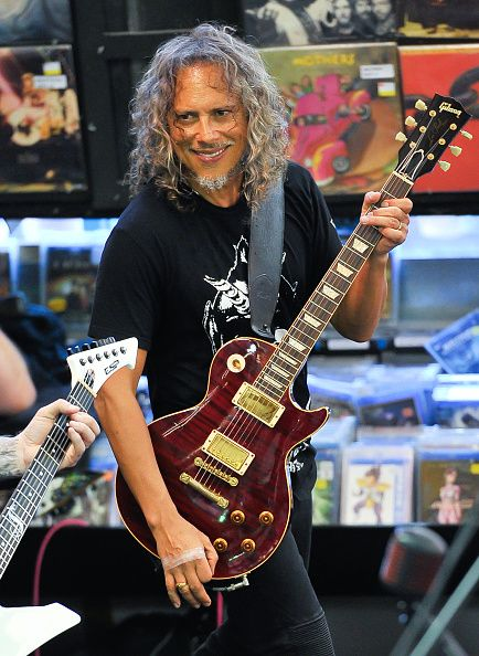 """Kirk with a Les Paul, possibly on Local Music Store day. Love his hair...this is what you call growing older gracefully. Awesome fit bod, handsome face, and gorgeous """"chrome"""" hair to match the hardware on his guitars :)"""