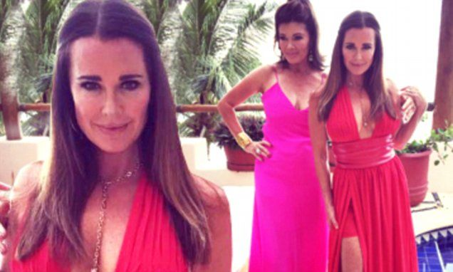 Kyle Richards shows off her ample cleavage in a plunging crimson dress
