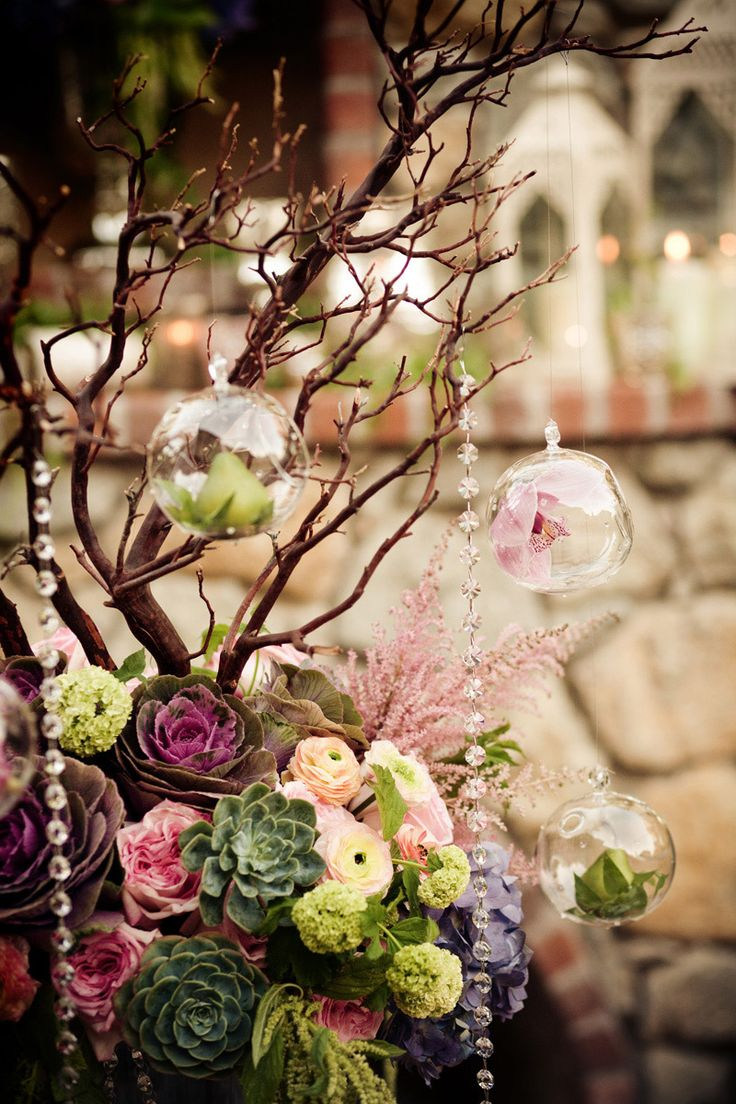 These glass globes look beautiful with flowers as well as tea lights