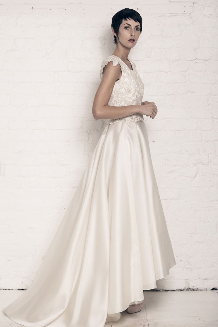 Modern wedding dress for the contemporary bride. Helen top, Olivia skirt. Corded lace top with applique cap sleeves and mini peplum. Silk organza waterfall skirt with tulle underskirt.