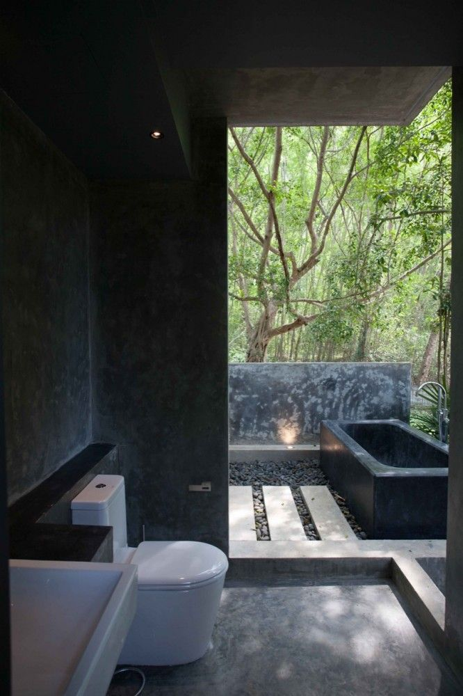 love the outdoor baths in se asia.  obviously need a specific piece of land to pull this off.  but very nice.