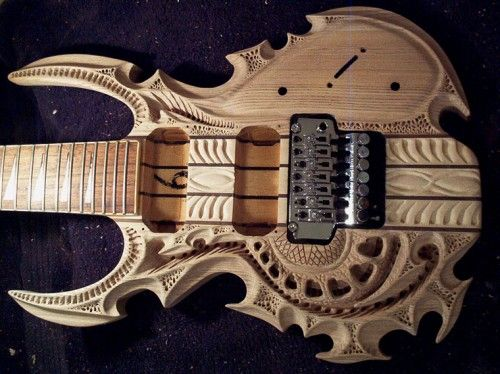 Grey Van Kuilenburg is a custom guitar builder. Pictured above is a body for a seven-string guitar that he carved and assembled from ash, bubinga, and rock maple. In an interview about his work, Kuilenburg described how involved is carving a guitar body that is not only beautiful, but functional