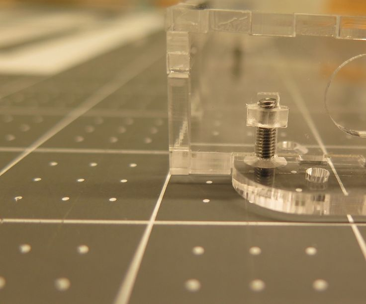 This instructable shows how to build a laser cut acrylic box with embedded nuts, which can be fastened by flat head screw.I've used polycarbonate nuts. This nut is transparent and can be bonded to acrylic with acrylic cement.