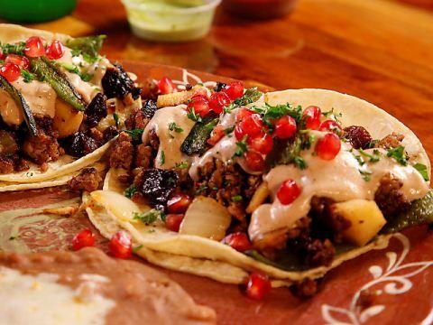 La Santisima Gourmet Tacos : Guy tastes the sweet-and-spicy gourmet tacos at La Santisima in Phoenix.