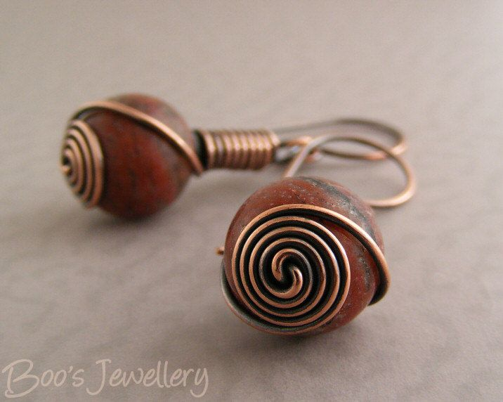 Antiqued copper earrings with red flower marble beads, spiral wrapped with a rosebud knot by boo jewels on etsy