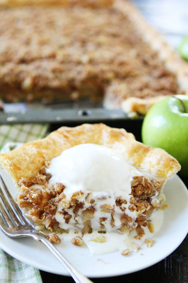 Apple Slab Pie with Crumb Topping Recipe on twopeasandtheirpod.com This easy apple pie is made in a jelly roll pan and is perfect for feeding a crowd. Add this pie to your Thanksgiving menu! It is sure to be a hit!