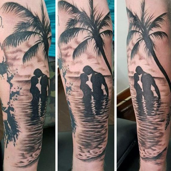 Man With Ocean Themed Tattoos Of Beaches On Forearm