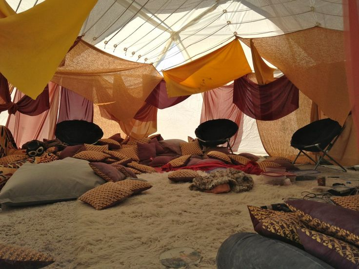 I Went To Burning Man And It Was Even Crazier Than I Expected - There was a communal tent filled with pillows, blow up couches, and chairs where everyone could hang out together.