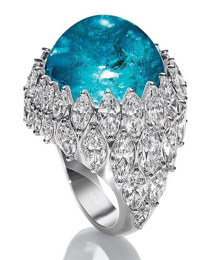 Have you seen anything more gorgeous??! Paraiba Tourmaline ring with marquise diamiamonds