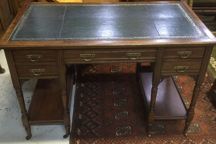 Victorian walnut desk with tooled leather top