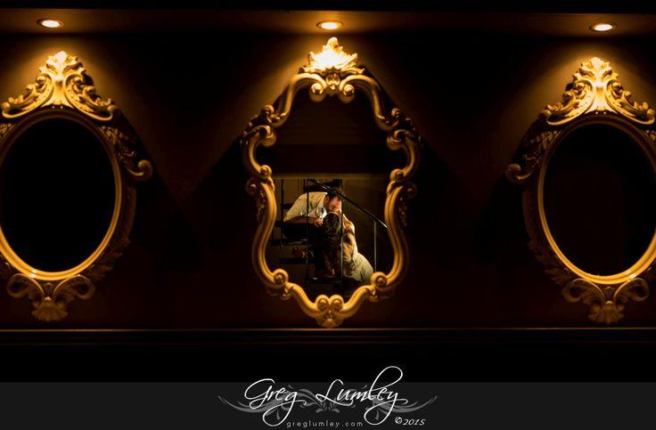 Creative wedding photography using mirrors.  Night time dramatic wedding photo.