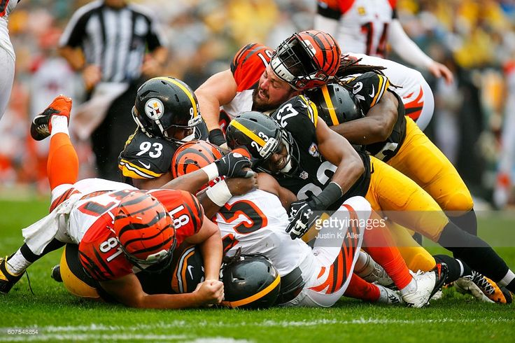 Mike Mitchell #23, Daniel McCullers #93 and Ricardo Mathews #90 of the Pittsburgh Steelers tackles Giovani Bernard #25 of the Cincinnati Bengals in the first half during the game at Heinz Field on September 18, 2016 in Pittsburgh, Pennsylvania.
