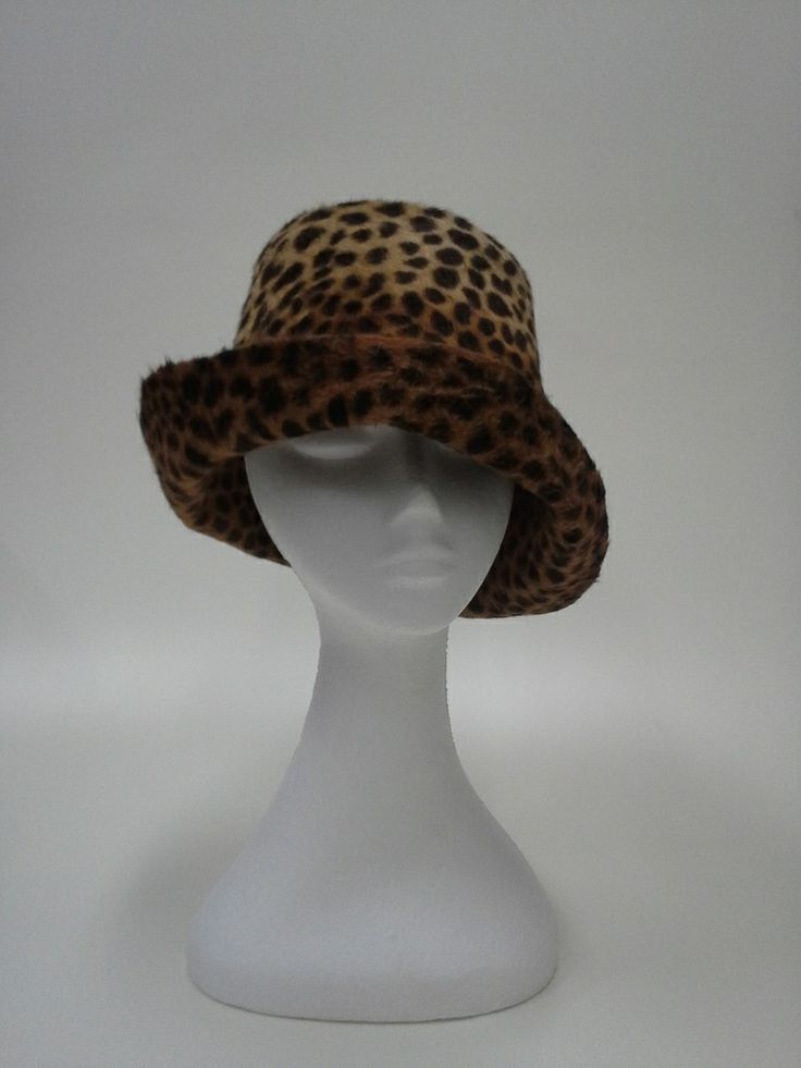 Leopard pattern on double-sided melusine felt.  This felt has a silky, luxurious texture.  The simple style allows the quality of the felt, exquisite pattern and its discerning wearer to shine through on any occasion during the cooler months.Add your own scarf or brooch for extra personality.  http://johannaguerinmilliner.bigcartel.com/product/leopard-winter-bucket