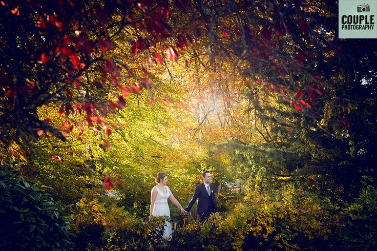 The Bride & Groom in the beautiful Autumnal colours, walk hand in hand through the light. An epic wedding photo! Wedding at Castle Dargan Hotel Photographed by Couple Photography. Ireland.