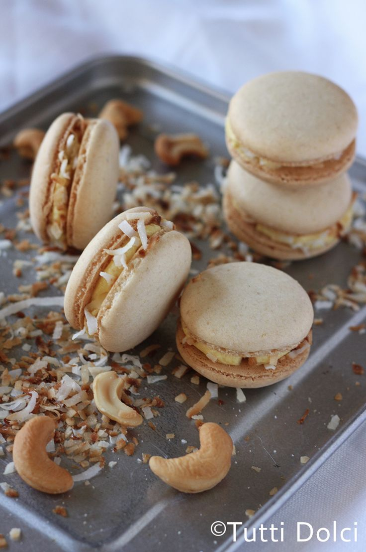 Mango, Cashew & Toasted Coconut Macarons - cashew macarons filled with fresh mango buttercream and toasted coconut flakes.