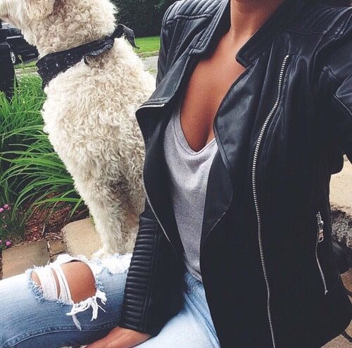 Leather coat and ripped faded jeans