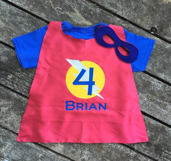 This Custom 3-Peice Superhero T-Shirt, Cape and Mask Set makes a perfect birthday gift, or a great outfit for comfy everyday superhero wear. Bring out the imaginative play in your child with this custom made set, personalized with any color combination and initial you choose. This listing features a Superhero T-Shirt with matching satin cape and coordinating reversible mask! Ultra soft velcro attaches/detaches cape on shoulders of shirt. T-Shirt can be worn alone, then quickly accessoriz...