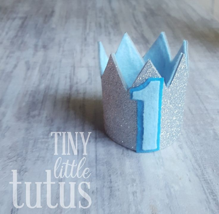 Blue and Silver First Birthday Crown. Change up the colors or the age if you like, make this crown anything you want for your little Prince or Princess! All custom requests are welcome.  Visit us on Facebook or Etsy for custom orders. Facebook link below photo, Etsy link on our main page. Fast shipping available.