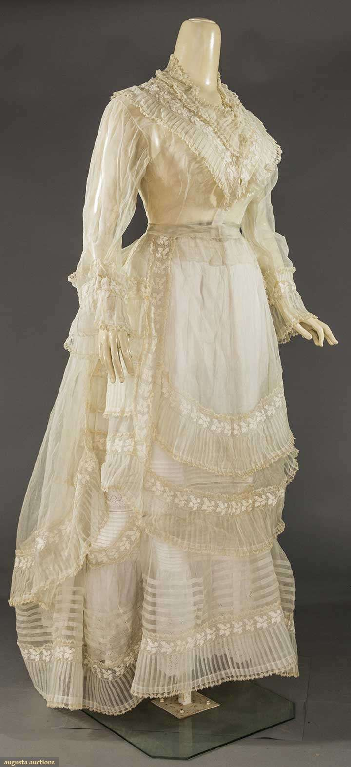 "ORGANDY & LACE DRESS PARTS, 1860-1870s | May 9, 2017 Sturbridge, Massachusetts |  1 incomplete dress, white organdy & acorn embroidered trim, c/o bodice, over-skirt & hem flounce, B to 38"", W 26"", Skirt L 28""-40"", (faint brown stains, W band dirty) very good"