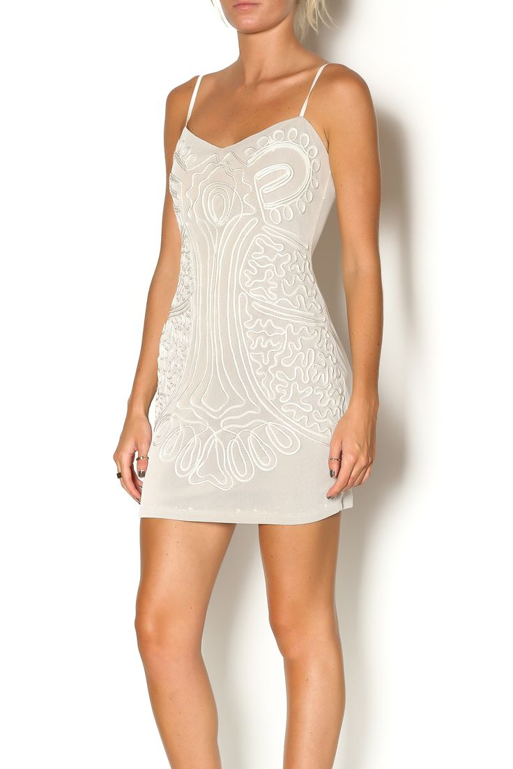 Mesh nude dress with white piping design down the front, spaghetti straps and a hidden back zip closure. This sexy mesh dress just turned your wardrobe up a notch. Wear with nude heels and gold arm cuff.