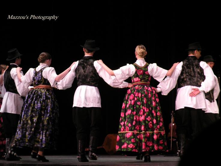 Duquesne University Tamburitzans 76th season.   Dancing the ''kolo'' (circle dance) in amazing Croatian (Vojvodina region) costumes!    Taken Nov. 2012 by myself. This show is still touring USA, if you want to see it yourself!
