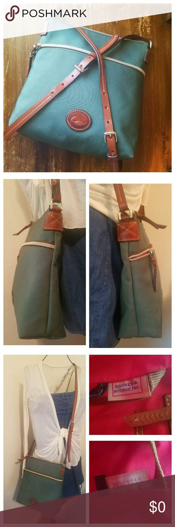Dooney & Bourke Nylon Crossbody D&B Teal Nylon Crossbody in excellent used condition. Brown leather accents including zipper pulls, shoulder strap & Dooney duck emblem. Patina/darkening of the leather is visible. Very clean interior. 1 front slip zip pocket. Main storage area has 1 zip & 1 slip pocket on the back wall & 2 small slip pockets on the front wall. Key finder cord. Serial #J9373715. From my 🚬🆓🐶🐱🆓🏠. 〰N🚫 TRADES, N🚫 HOLDS, N🚫 LOWBALL OFFERS〰 Dooney & Bourke Bags Crossbody…