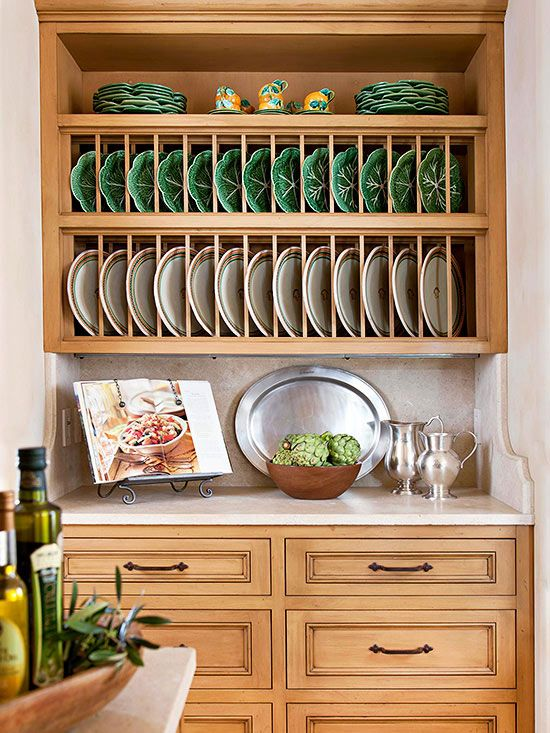 Install a large plate rack to add a twist to traditional open shelving. This simple storage option is perfect for displaying china sets in a stylish and sophisticated way, while still making practical use of space. Arrange extra pieces of the tableware set, such as glasses or saucers, above the plate rack to complete the look.