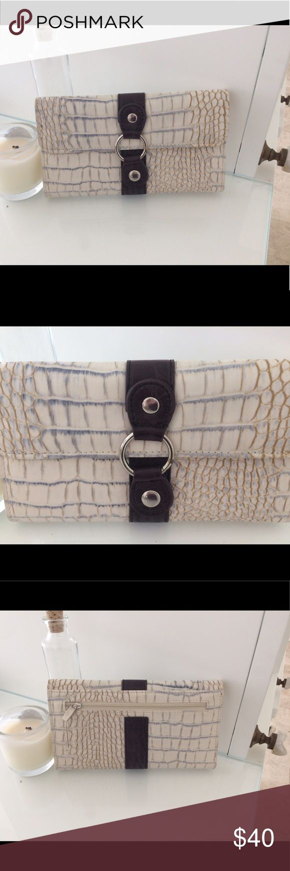 Lightly used beautiful animal print clutch/wallet! Lots of slips for all of your cards, a great piece! Black Rivet Bags