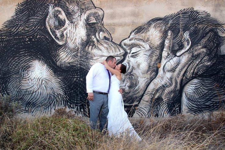 Graffiti is the backdrop for this lucky bride and groom - Alyko beach abandoned hotel - Naxos Greece #destinationwedding #naxosweddings #greeceweddings #graffitiweddings