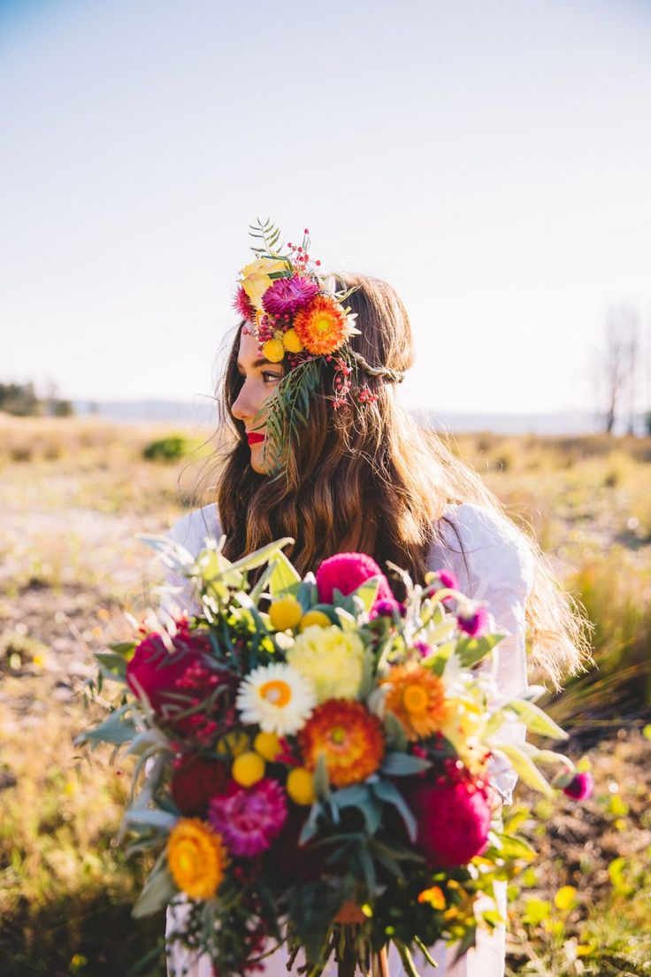 boho bride with colourful flower crown and bouquet