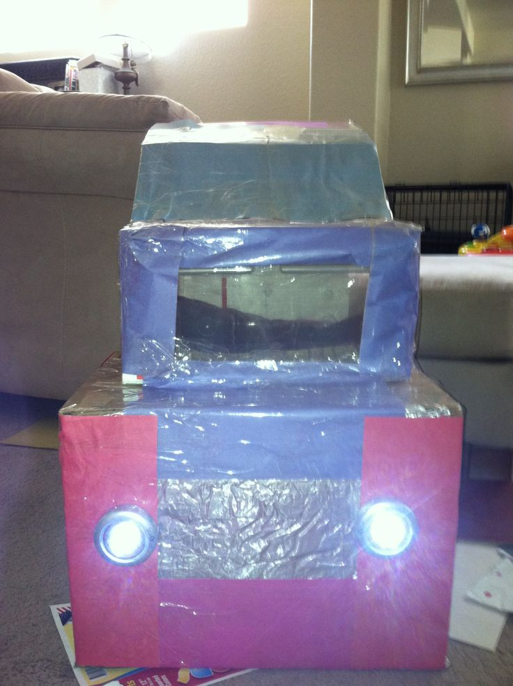 The front of the car.  We used construction paper and packing tape for the color part of the car and tin foil for the metal parts. The headlights are the stick-on battery operated lights.