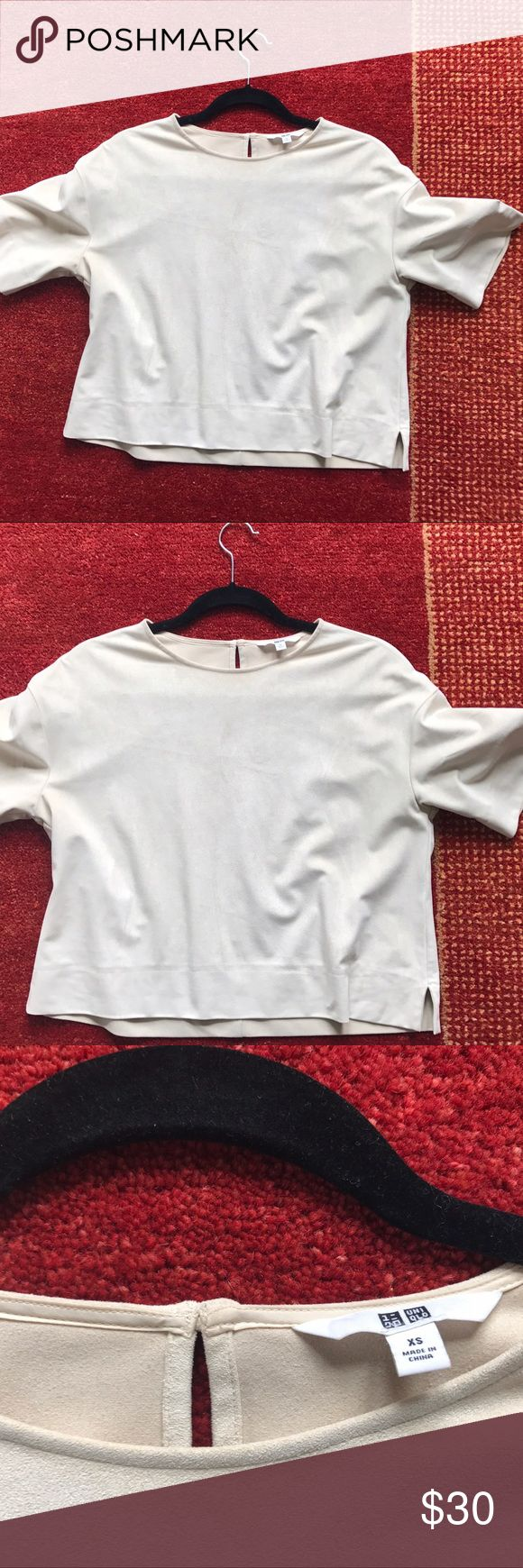 Clear cut suede Uniqlo shirt Cut clean white shirt. The texture is suede and the fabric is thick. This is perfect to wear with jeans and heels. Go for a impeccable look with this! Uniqlo Tops Blouses