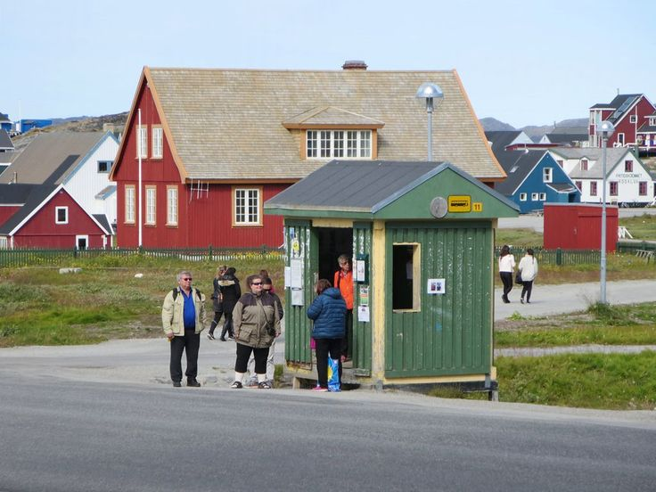 Passengers await a city bus at a stop in Nuuk, Greenland.