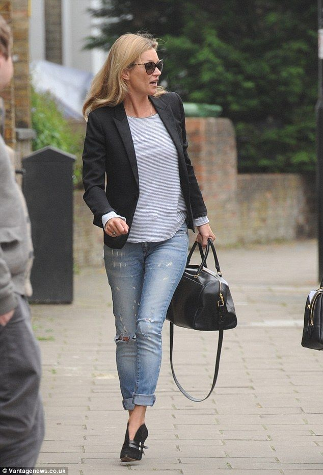 kate moss looks cool in ripped denim and sexy pixie boots