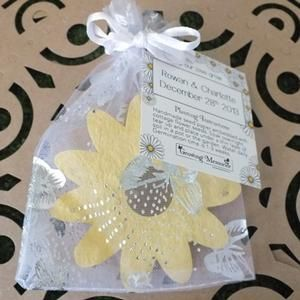 A seed paper shape in a white organza bag with a personalised tag. You choose the shape and give your guests a lasting memory and seeds that will grow in  a pot or the garden.