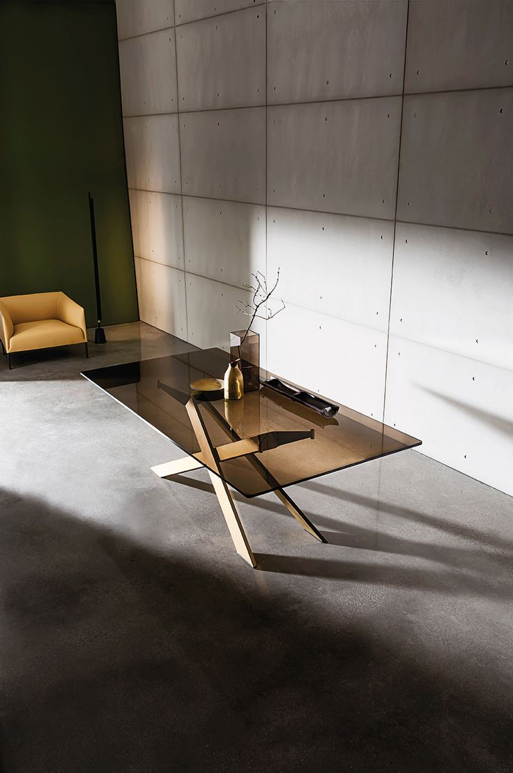 Elegance for your space with Cross table designed by Gianluigi Landoni with bronzed glass top and burnished metal base. #Sovetitalia #glassdesign #interior #inspiration
