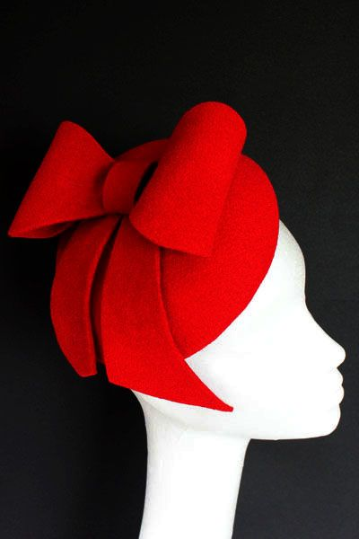Red felt hat with small bow. Small hat perfect for a wedding guest or day at the races.