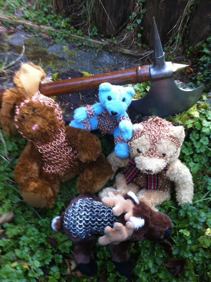 A gaggle of stuffed animals in chain mail.  Bears, Bunny, and Reindeer