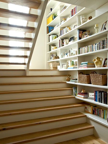 Space Maximizing Bookshelves- Open stair treads allow natural light to pass through, reducing the need for energy-guzzling artificial light. Built-in bookshelves maximize space and give this stairway personality. (Photo: Jeff McNamara)