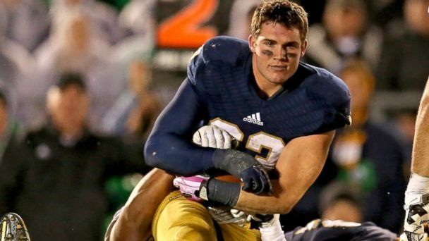 The Internet is abuzz after a camera caught Notre Dame football player Cam McDaniel without his helmet during a play.