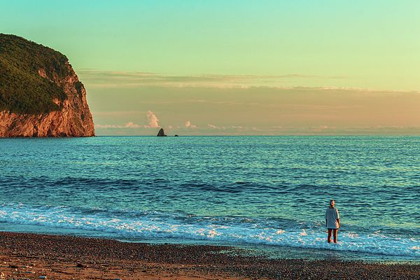 A warm summer evening a woman admires a calm sea and setting sun by George Westermak,  Cozy Montenegro is an inexpensive and high-quality beach holidays on the Adriatic, Orthodox monasteries and medieval attractions, lakes and national parks #George Westermak#travel#FineArtPrints#landscape#Photography#Montenegro