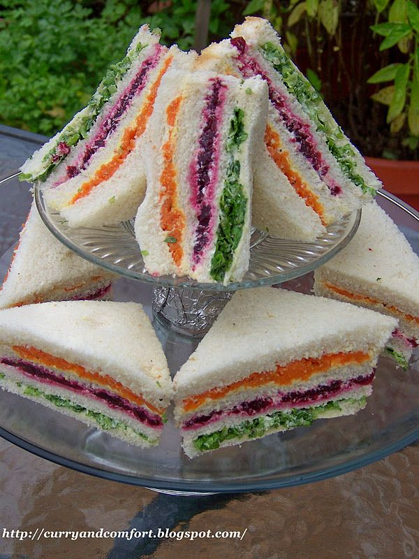 Ribbon Tea Sandwiches:  Carrots  Beets  Lettuce  Butter or Mayo  Bread  Butter each slice of bread and put a layer of the the vegetables.    Note: You will actually use 4 slices of bread for each sandwich.