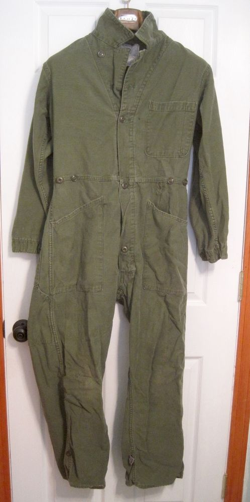 """Men's Army Cotton, Sateen Type 1 Coveralls. Size Medium. In used condition. Laying flat with overall buttoned the pit to pit is 23"""". A couple of small snags on the front and some repair jobs as only the Army can do. 