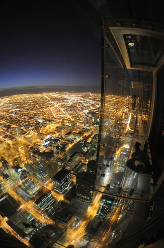 Ok, I've been on that Skydeck on the Sears Tower before, but what that dude is going over there just rocks.  I would love to just chill there like that some night.  Wow. ~ KK